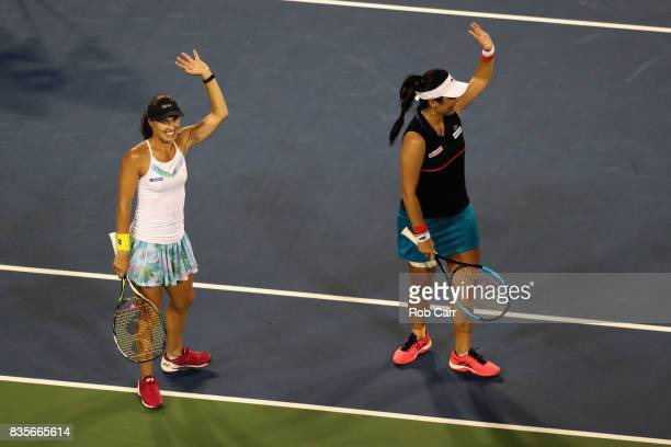 Martina Hingis of Switzerland celebrates with doubles partner YungJan Chan of Chinese Taipei after defeating Monica Niculescu of Romania and SuWei...