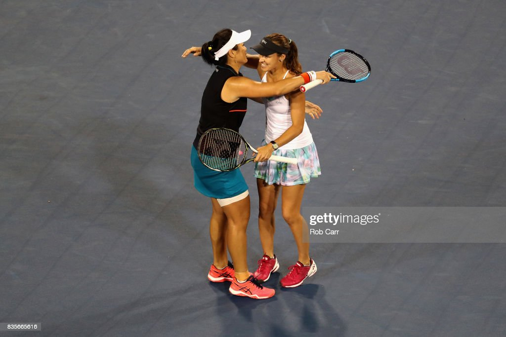 Martina Hingis of Switzerland (R) hugs doubles partner Yung-Jan Chan of Chinese Taipei after defeating Monica Niculescu of Romania and Su-Wei Hsieh of Taipei to win the Western and Southern Open Women's doubles final during Day 8 at the Linder Family Tennis Center on August 19, 2017 in Mason, Ohio.