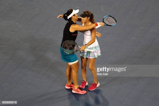 Martina Hingis of Switzerland hugs doubles partner YungJan Chan of Chinese Taipei after defeating Monica Niculescu of Romania and SuWei Hsieh of...