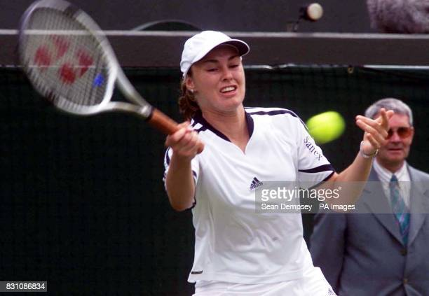 Martina Hingis of Switzerland in action against Spain's MariaAngeles Montolio during the first day of the Lawn Tennis Championships at Wimbledon