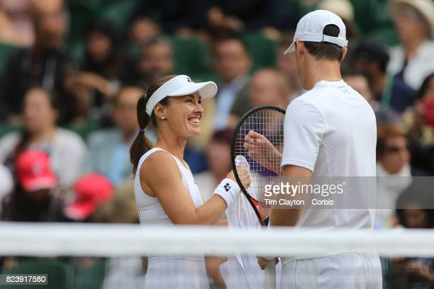 Martina Hingis of Switzerland in action with Jamie Murray of Great Britain during the Mixed Doubles Semi Final on Center Court during the Wimbledon...