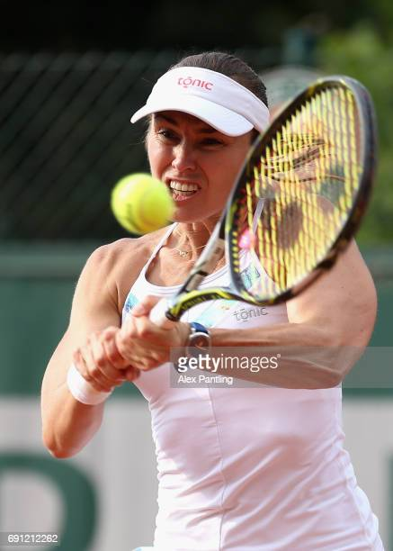 Martina Hingis of Switzerland partner of YungJan Chan of Taipei plays a forehand during the ladies doubles first round match against Naomi Brady of...