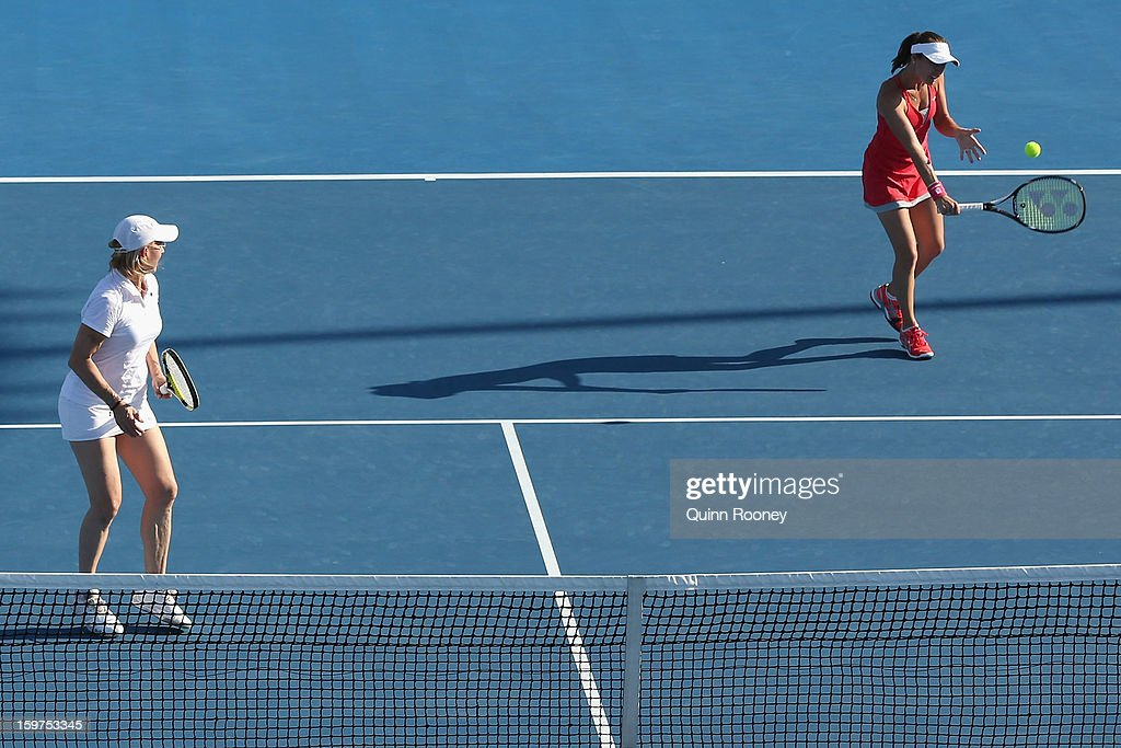 Martina Hingis of Switzerland plays a backhand in her legends doubles match with Martina Navratilova of the United States of America against Iva Majoli of Croatia and Barbara Schett Austria during day seven of the 2013 Australian Open at Melbourne Park on January 20, 2013 in Melbourne, Australia.