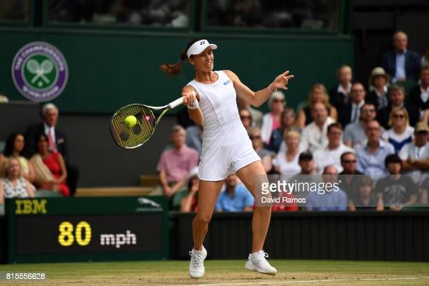 Martina Hingis of Switzerland plays a forehand during the Mixed Doubles final match against Heather Watson of Great Britain and Henri Kontinen of...