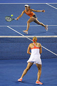 Martina Hingis of Switzerland plays a forehand in her women's doubles final match with Sania Mirza of India against Andrea Hlavackova and Lucie...