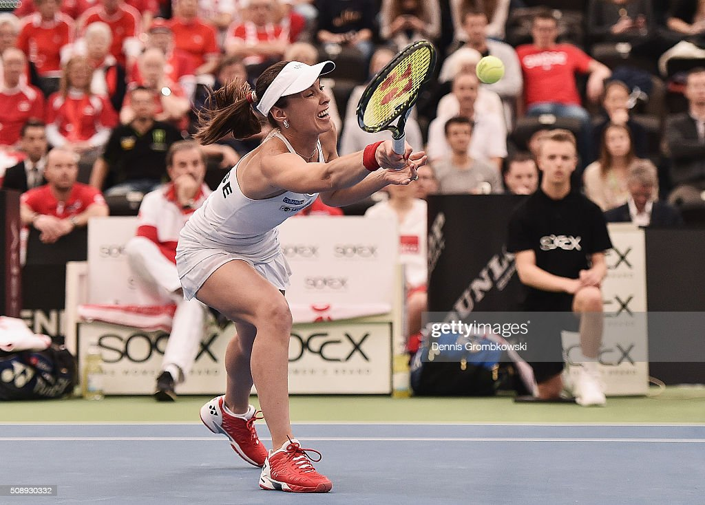 <a gi-track='captionPersonalityLinkClicked' href=/galleries/search?phrase=Martina+Hingis&family=editorial&specificpeople=202183 ng-click='$event.stopPropagation()'>Martina Hingis</a> of Switzerland plays a forehand n her double match with Belinda Bencic on Day 2 of the 2016 FedCup World Group Round 1 match between Germany and Switzerland at Messe Leipzig on February 7, 2016 in Leipzig, Germany.