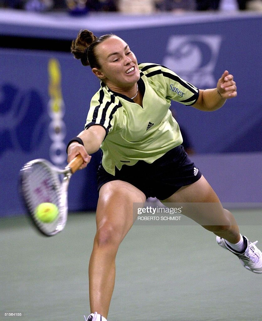 Martina Hingis of Switzerland returns a serve by M
