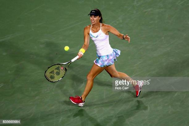 Martina Hingis of Switzerland returns a shot with doubles partner YungJan Chan of Chinese Taipei while playing against Monica Niculescu of Romania...