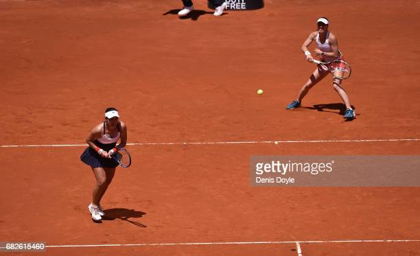 Martina Hingis of Switzerland returns a shot with her doubles partner YungJan Chan of Teipei during their women's doubles final match against Tomea...