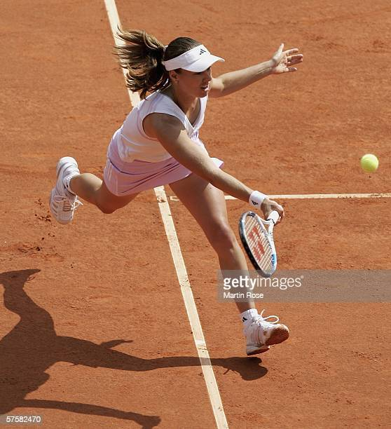 Martina Hingis of Switzerland returns to Elena Dementieva of Russia during the fourth day of the Womens Qatar Telecom German Open at the Rot Weiss...