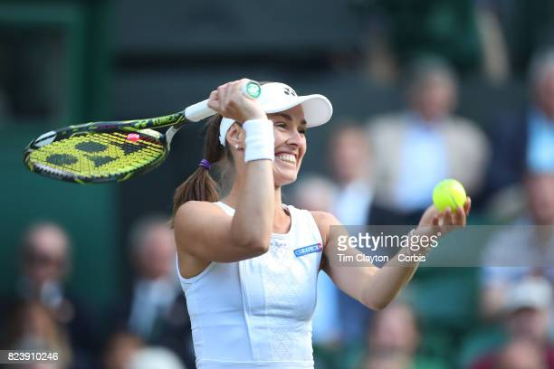 Martina Hingis of Switzerland shares a light hearted moment while playing with Jamie Murray of Great Britain during the Mixed Doubles Semi Final on...