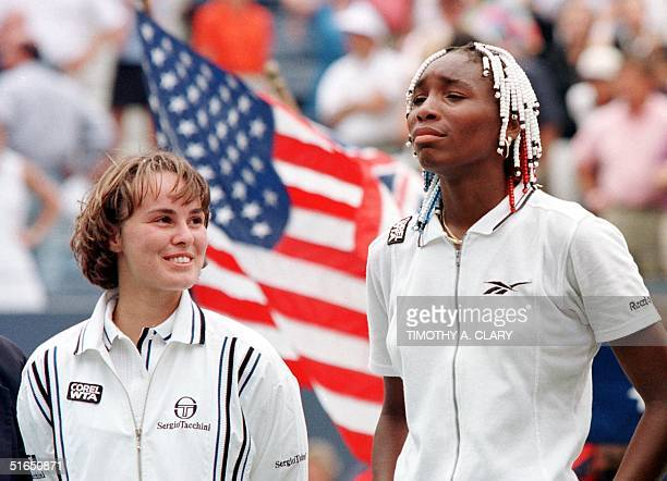 Martina Hingis of Switzerland stands with Venus Williams of the US 07 September after their women's final match at the US Open in Flushing Meadows NY...