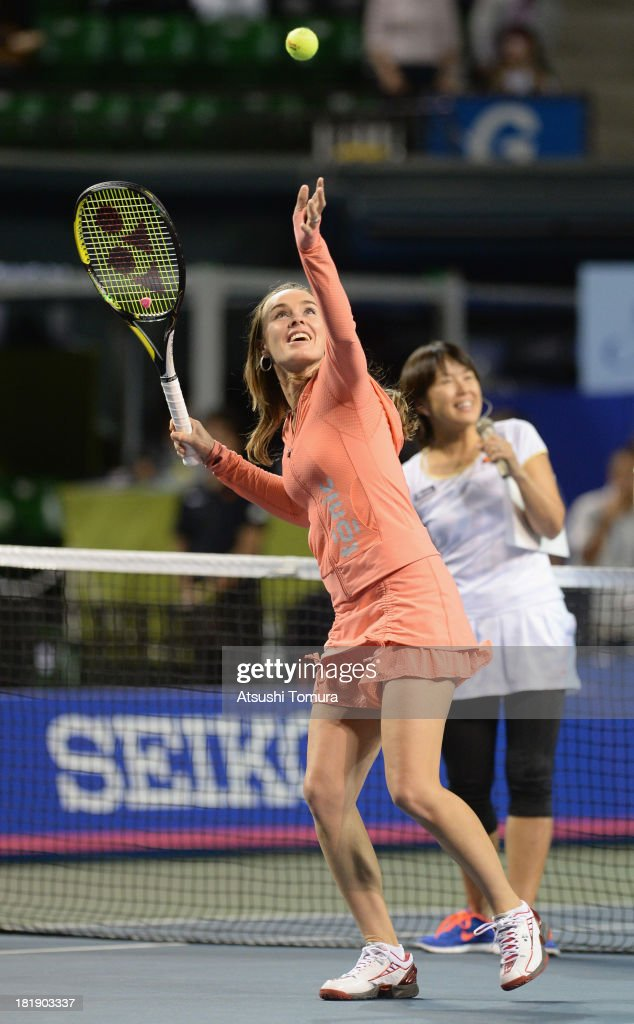 Martina Hingis shoots autographed balls to the audience during day five of the Toray Pan Pacific Open at Ariake Colosseum on September 26, 2013 in Tokyo, Japan.