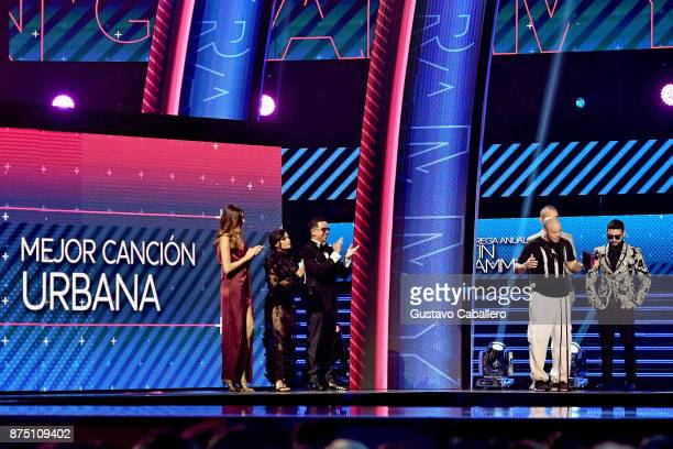 Martina La Peligrosa and J Alvarez listen as Residente accepts the Best Urban Song award for 'Somos Anormales' onstage during The 18th Annual Latin...