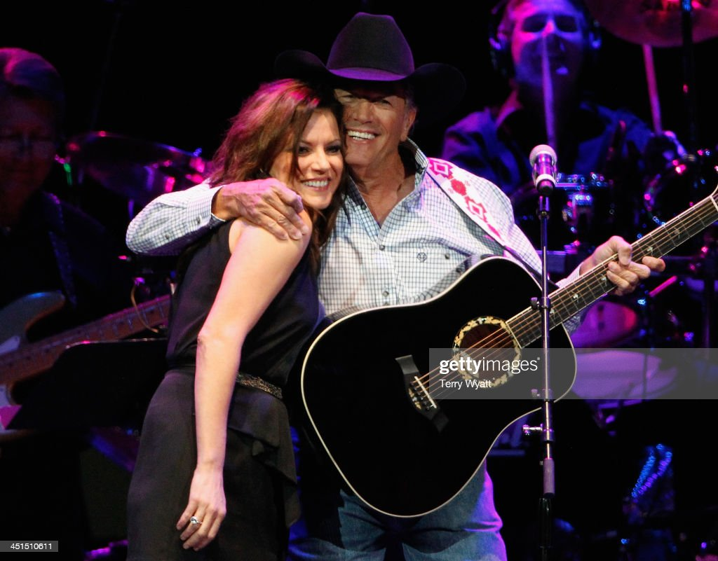 <a gi-track='captionPersonalityLinkClicked' href=/galleries/search?phrase=Martina+McBride&family=editorial&specificpeople=204772 ng-click='$event.stopPropagation()'>Martina McBride</a> and <a gi-track='captionPersonalityLinkClicked' href=/galleries/search?phrase=George+Strait&family=editorial&specificpeople=234588 ng-click='$event.stopPropagation()'>George Strait</a> perform during Playin' Possum! The Final No Show Tribute To George Jones - Show at Bridgestone Arena on November 22, 2013 in Nashville, Tennessee.