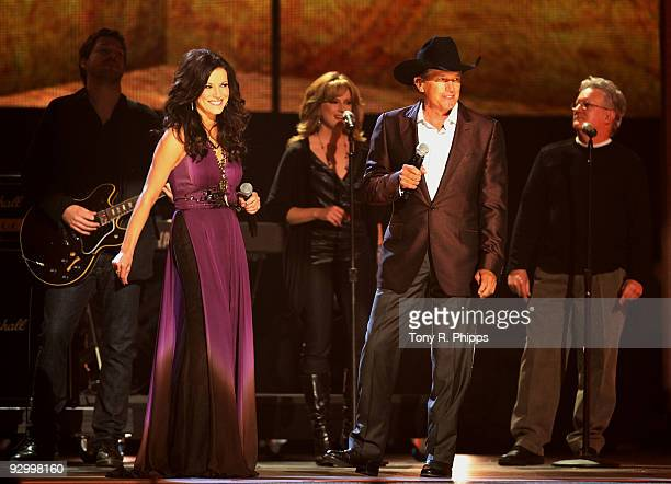 Martina McBride and George Strait perform onstage at the 43rd Annual CMA Awards at the Sommet Center on November 11 2009 in Nashville Tennessee