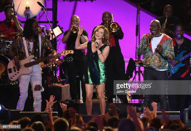 Martina McBride performs onstage with Verdine White and Philip Bailey of Earth Wind Fire during CMT Crossroads Earth Wind Fire and Friends on June 6...