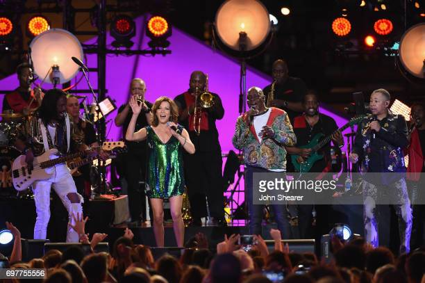 Martina McBride performs onstage with Verdine White Philip Bailey and Ralph Johnson of Earth Wind Fire during CMT Crossroads Earth Wind Fire and...