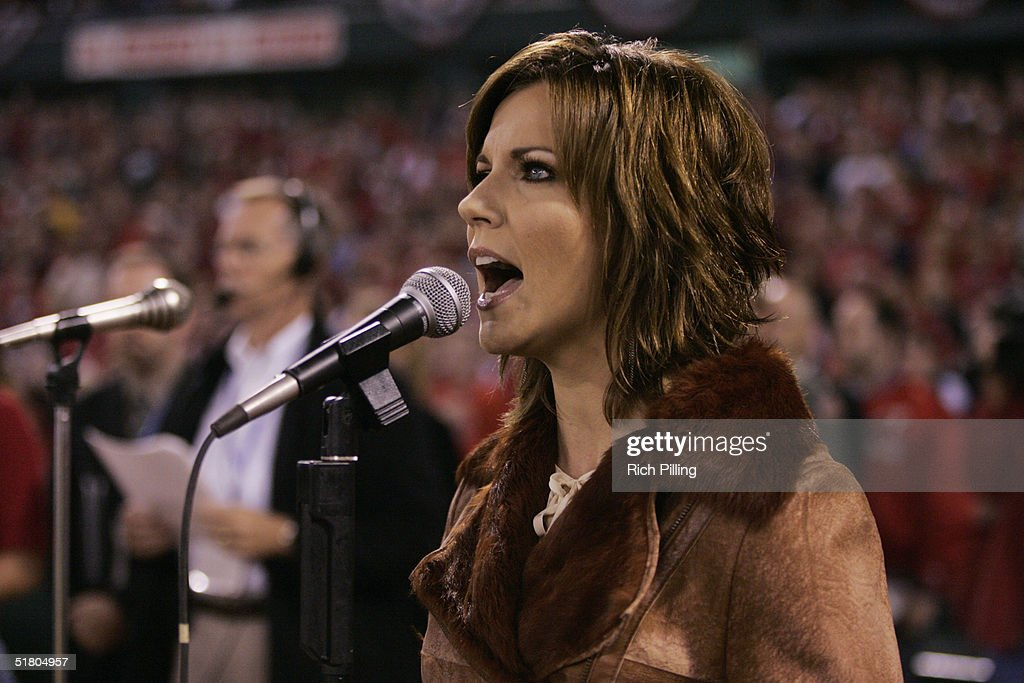 Martina McBride sings the National Anthem prior to game three of the 2004 World Series between the Boston Red Sox and St. Louis Cardinals at Busch Stadium on October 26, 2004 in St. Louis, MO. The Red Sox defeated the Cardinals 4-1. (Photo by Rich Pilling/ MLB Photos via Getty Images).