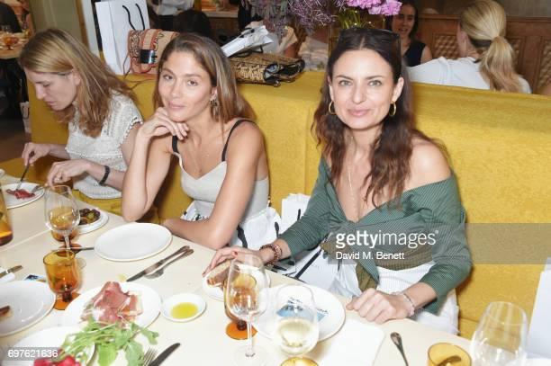 Martina Mondadori Sartogo Quentin Jones and Gabriele Hackworthy attend the Isa Arfen x Alex Eagle lunch at The Chess Club on June 19 2017 in London...
