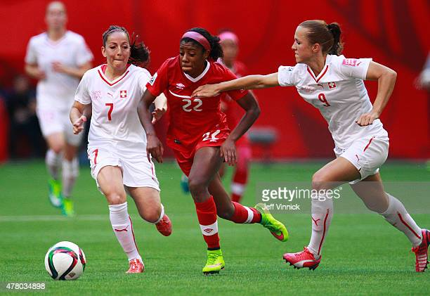 Martina Moser and Lia Walti of Switzerland defend against Ashley Lawrence of Canada during the FIFA Women's World Cup Canada 2015 Round 16 match...