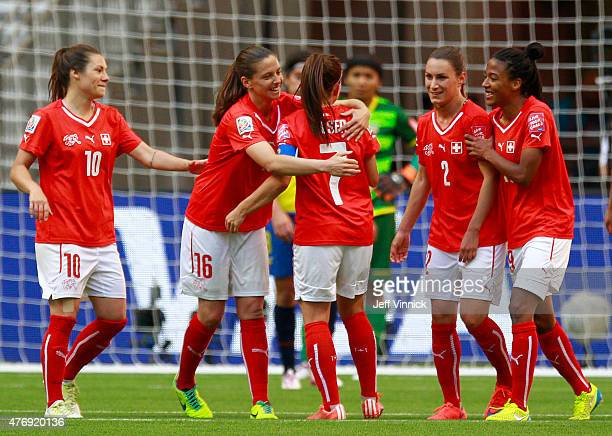 Martina Moser of Switzerland is congratulated by teammate Fabienne Humm after scoring during the FIFA Women's World Cup Canada 2015 Group C match...