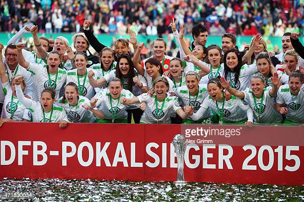 Martina Mueller and team mates celebrate winning the Women's DFB Cup Final between Turbine Potsdam and VfL Wolfsburg at RheinEnergieStadion on May 1...