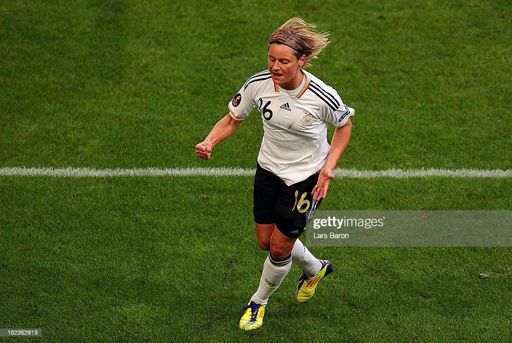 Martina Mueller of Germany celebrates after scoring a goal during the UEFA Womens Euro 2013 qualification match between Germany and Turkey at Schauinsland-Reisen-Arena on September 19, 2012 in Duisburg, Germany.
