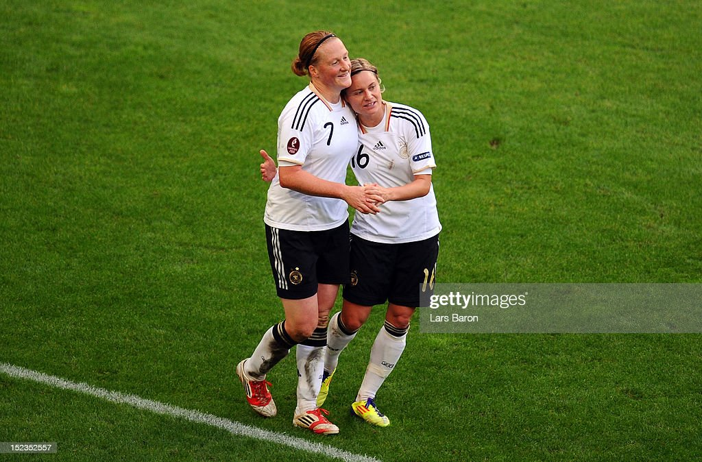 Martina Mueller of Germany celebrates with team mate <a gi-track='captionPersonalityLinkClicked' href=/galleries/search?phrase=Melanie+Behringer&family=editorial&specificpeople=766499 ng-click='$event.stopPropagation()'>Melanie Behringer</a> during the UEFA Womens Euro 2013 qualification match between Germany and Turkey at Schauinsland-Reisen-Arena on September 19, 2012 in Duisburg, Germany.