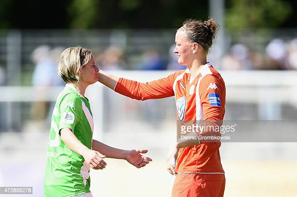 Martina Mueller of VfL Wolfsburg and team mate Almuth Schult react after the Allianz FrauenBundesliga match between 1 FFC Frankfurt and VfL Wolfsburg...