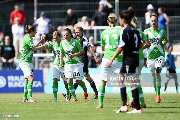 Martina Mueller of VfL Wolfsburg celebrates with team mates as she scores their first goal during the Allianz FrauenBundesliga match between 1 FFC...