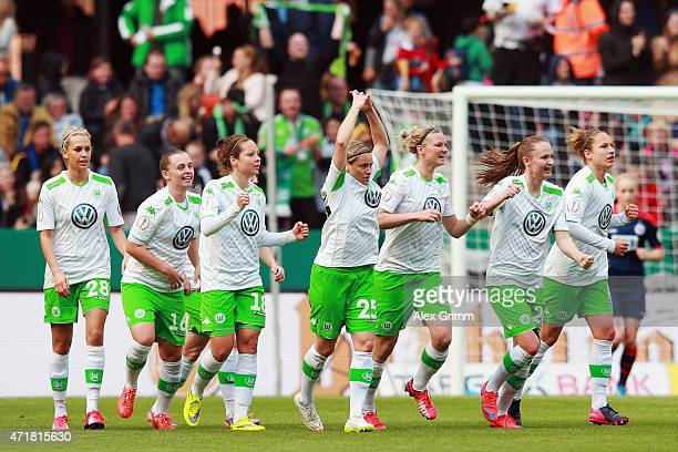 Martina Mueller of Wolfsburg celebrates her team's first goal with team mates during the Women's DFB Cup Final between Turbine Potsdam and VfL...