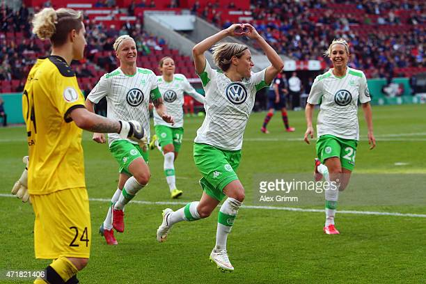 Martina Mueller of Wolfsburg celebrates her team's second goal with team mates as goalkeeper AnnaFelicitas Sarholz of Potsdam reacts during the...