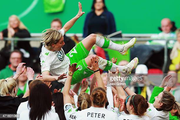 Martina Mueller of Wolfsburg celebrates with team mates after winning the Women's DFB Cup Final between Turbine Potsdam and VfL Wolfsburg at...