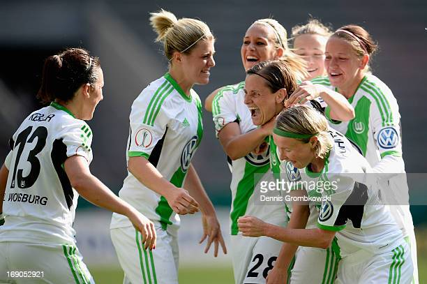 Martina Mueller of Wolfsburg celebrates with teammates after scoring his team's second goal during the Women's DFB Cup Final between VfL Wolfsburg...