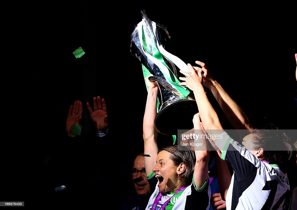 Martina Muller of VfL Wolfsburg and team-mates celebrate with the trophy after winning the UEFA Women's Champions League final match between VfL Wolfsburg and Olympique Lyonnais at Stamford Bridge on May 23, 2013 in London, England.