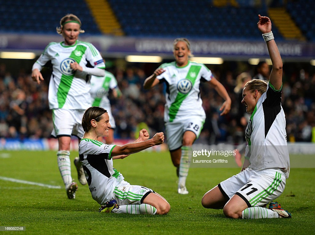 Martina Muller (L) of VfL Wolfsburg celebrates scoring the opening goal from the penalty spot with <a gi-track='captionPersonalityLinkClicked' href=/galleries/search?phrase=Alexandra+Popp&family=editorial&specificpeople=703429 ng-click='$event.stopPropagation()'>Alexandra Popp</a> (R) of VfL Wolfsburg during the UEFA Women's Champions League Final Match between VfL Wolfsburg and Olympique Lyonnais at Stamford Bridge on May 23, 2013 in London, England.