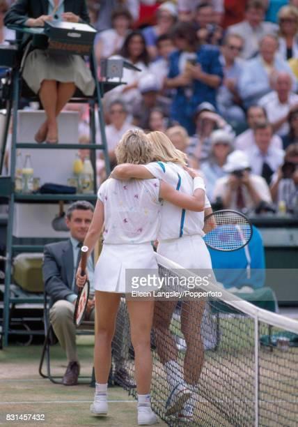 Martina Navratilova and Chris Evert of the USA embrace following Navratilova's victory during a women's semifinal singles match at the Wimbledon Lawn...
