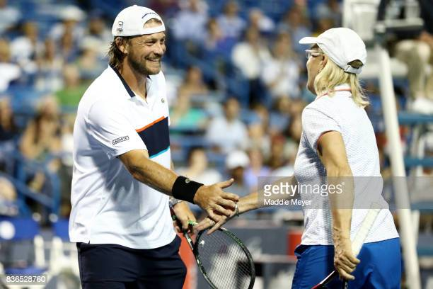 Martina Navratilova and her partner Cameron Lickle celebrate during an exhibition match on Day 4 of the Connecticut Open at Connecticut Tennis Center...
