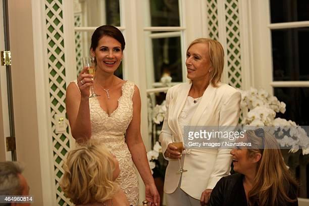 Martina Navratilova and Julie Lemigova make a toast at the Martina Navratilova and Julie Lemigova wedding reception on February 14 2015 in Palm Beach