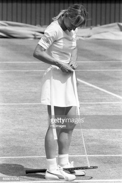 Martina Navratilova fastening her skirt after it came loose during the final which she went on to win 60 63