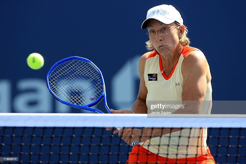 Martina Navratilova hits a backhand while playing with Nadia Petrova of Russia against Samantha Stosur of Australia and Lisa Raymond during the US...