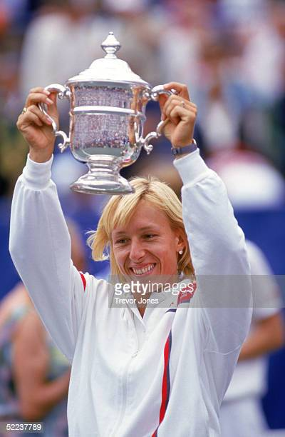 Martina Navratilova hoists her trophy as she celebrates winning the Women's US Open title in August of 1986 at Flushing Meadows in New York