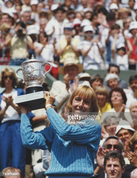 Martina Navratilova of the United States holds the SuzanneLenglen Cup after her victory over Chris Evert during their Women's Singles Final match at...