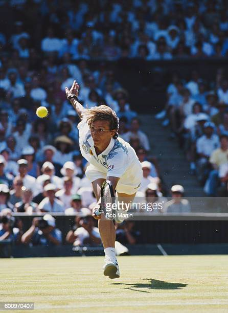 Martina Navratilova of the United States makes a return during the Women's Singles match against Helena Sukova at the Wimbledon Lawn Tennis...