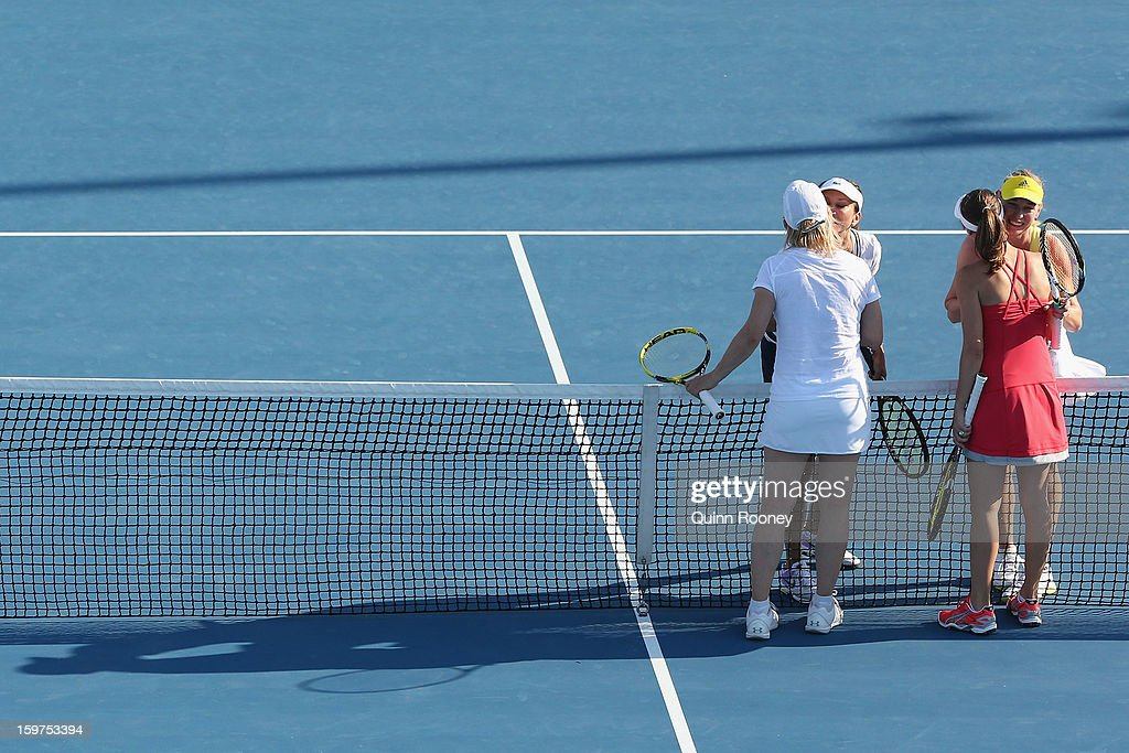 Martina Navratilova of the United States of America and Martina Hingis of Switzerland are congratulated by Iva Majoli of Croatia and Barbara Schett Austria after winning their legends doubles match during day seven of the 2013 Australian Open at Melbourne Park on January 20, 2013 in Melbourne, Australia.