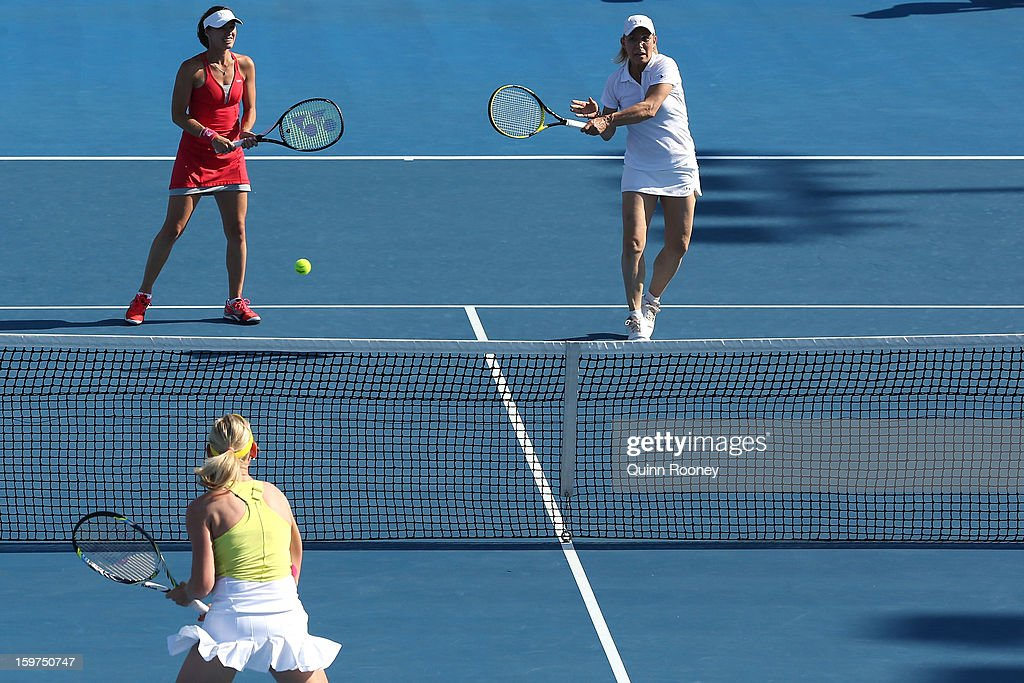 Martina Navratilova of the United States plays a shot in her third round legends doubles match with Martina Hingis of Switzerland against Iva Majoli of Croatia and Barbara Schett of Austria during day seven of the 2013 Australian Open at Melbourne Park on January 20, 2013 in Melbourne, Australia.