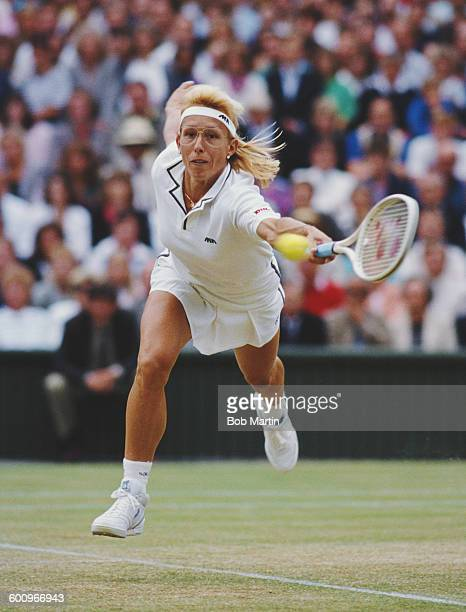 Martina Navratilova of the United States stretches to make a return during the Women's Singles Final match against Steffi Graf at the Wimbledon Lawn...
