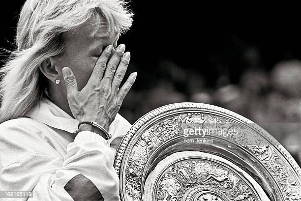Martina Navratilova of the United States wipes a tear away as she parades around Centre Court with the women's singles trophy after beating Zina...