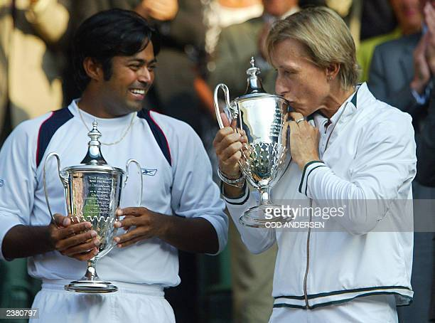 Martina Navratilova of the US kisses her trophy as Leander Paes of India watches after they won their Mixed Doubles Final over Andy Ram of Israel and...